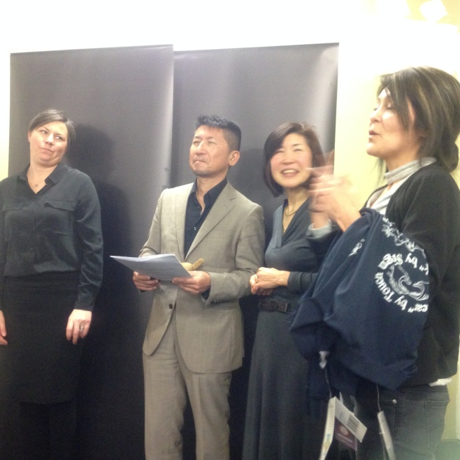 Paola with Japanese deafblind visitor at forum hosted by DBV